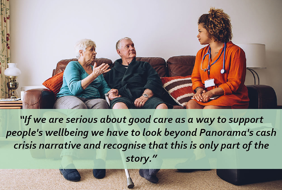 Elderly couple sitting on sofa chatting to healthcare professional
